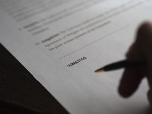 picture shows a document and pen