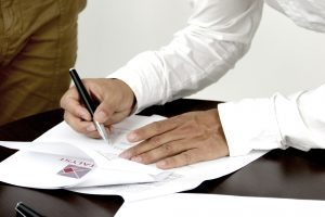 picture shows man writing documents